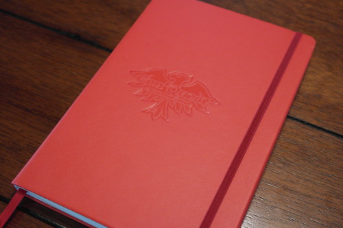 Free with purchase! Logo embossed on cover.